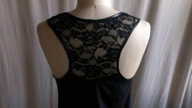 Racer back of tank top inset with lace trimmed with leather binding