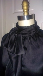 neck bow detail of silk blouse