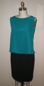 rounded front neckline of silk top.