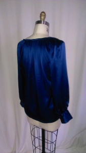 silk charmeuse raglan sleeve top with pleated neckline.