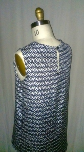 back of top with loop and button closure